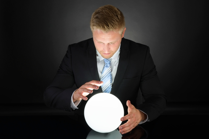 Portrait Of Businessman With Crystal Ball
