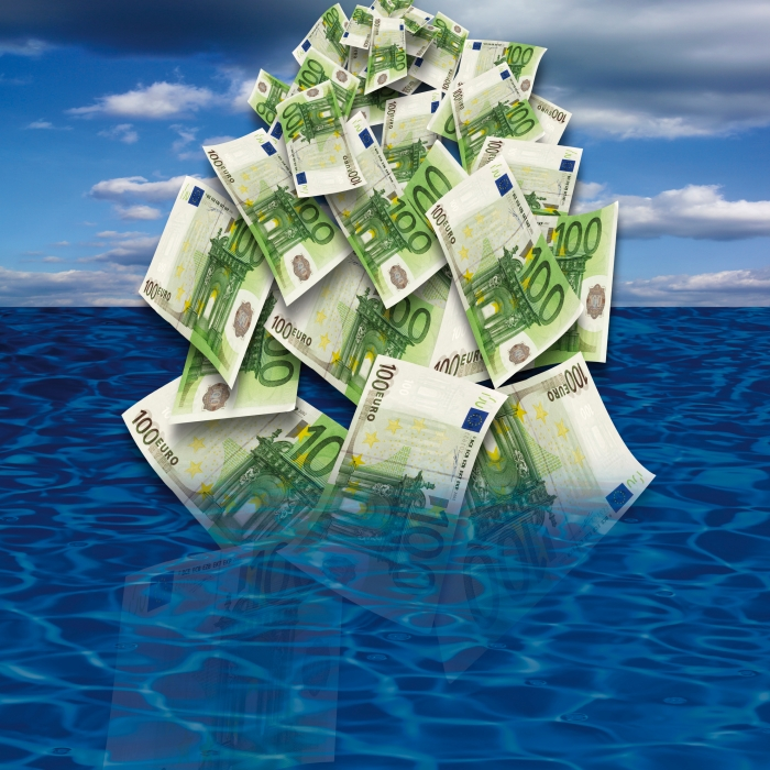 100 euro banknote drowing in sea, close-up
