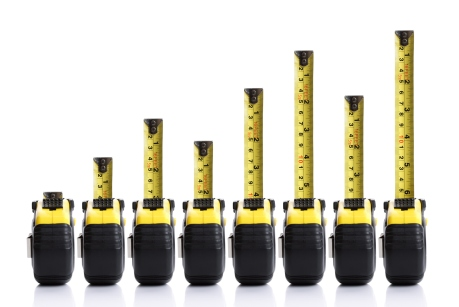 Tape measure bar graph concept with positive trend