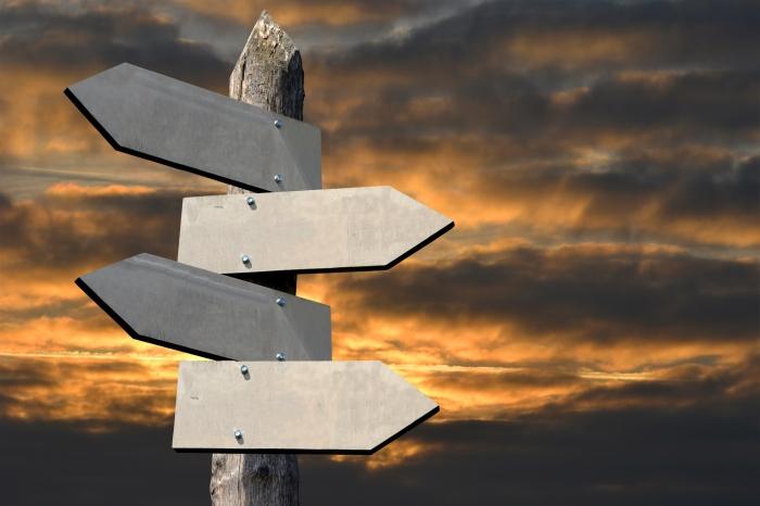 Wooden signpost - crossroads