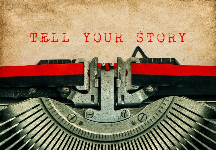 Typewriter Grungy paper background TELL YOUR STORY