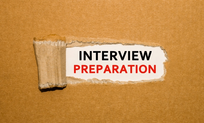 Text Interview Preparation appearing behind torn brown paper