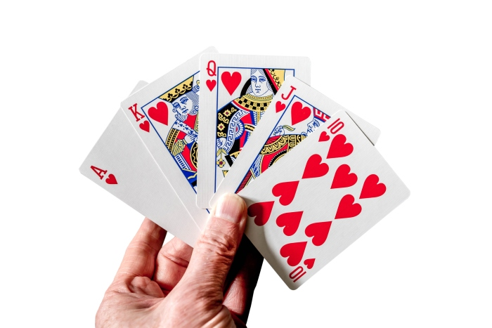 Royal flush poker hand cards isolated on white